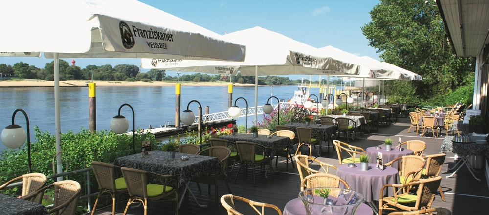 Terrace with perfect voew over the Weser river in the Ringhotel Faehrhaus Farge in Bremen-Farge, 4-stars hotel in Bremen