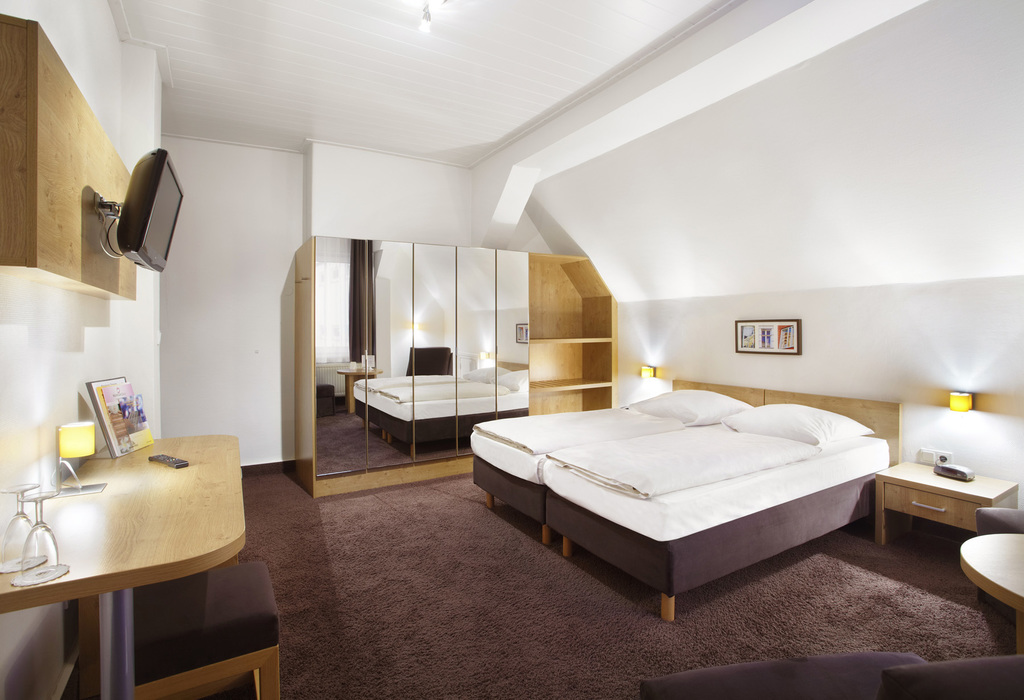 The rooms of the the 3-star hotel Ringhotel Jensen in Luebeck are situated on the historic old-town island