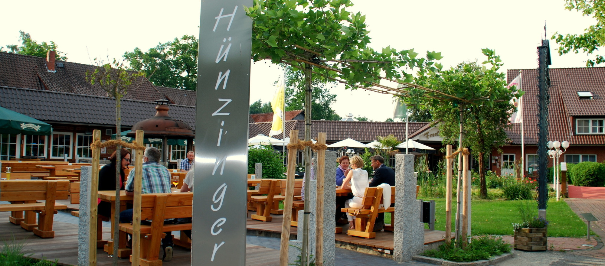 Beer garden in front of the Hünzinger Brauhaus at the Ringhotel Forellenhof in Walsrode, 4-stars Hotel in the Lueneburger Heide