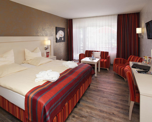 New designed rooms with carpet inlay or wood floor at the 4-star Ringhotel Posthotel Usseln in Willingen