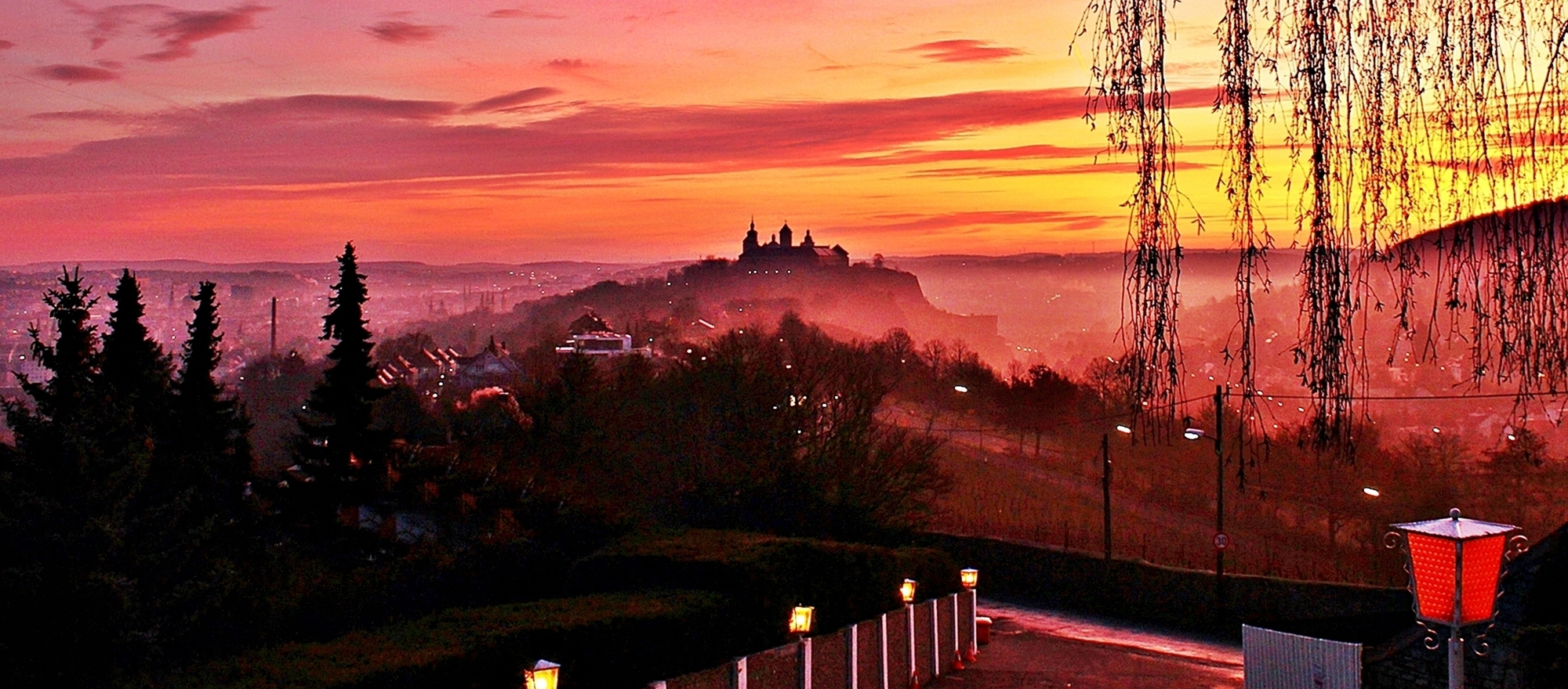 Enjoy the sunrise over the rooftops of Würzburg from the terrace of the 3-star Superior Hotel Ringhotel Wittelsbacher Hoeh