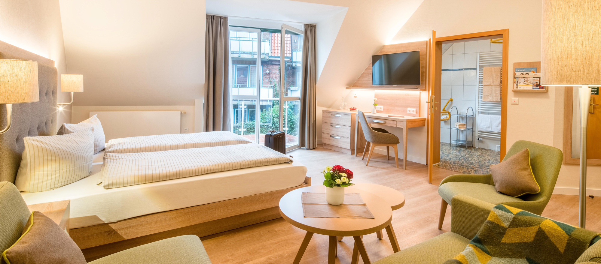 Bright and modern rooms at the 4-star hotel Ringhotel Altes Zollhaus in Horumersiel