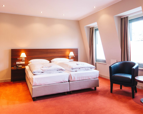 Junior Suite at the 4-star hotel Ringhotel Kocks at Muehlenberg garni in Muelheim