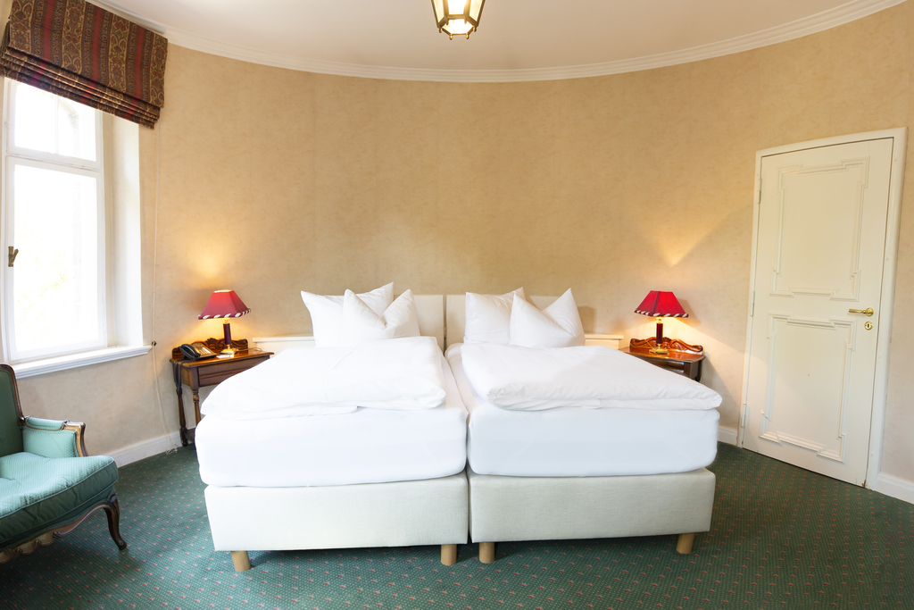 Experience a memorable stay in the tower double room at the Ringhotel Villa Westerberge, 3-star hotel in Aschersleben