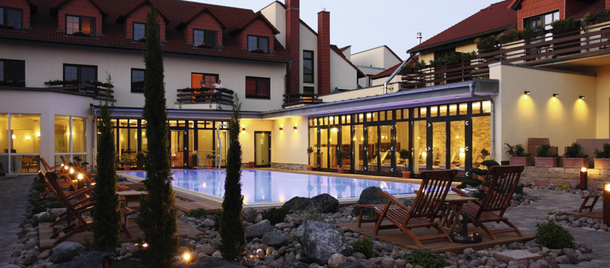 Evening mood at the outdoor pool in the 4-star hotel Ringhotel Zum Stein in Woerlitz