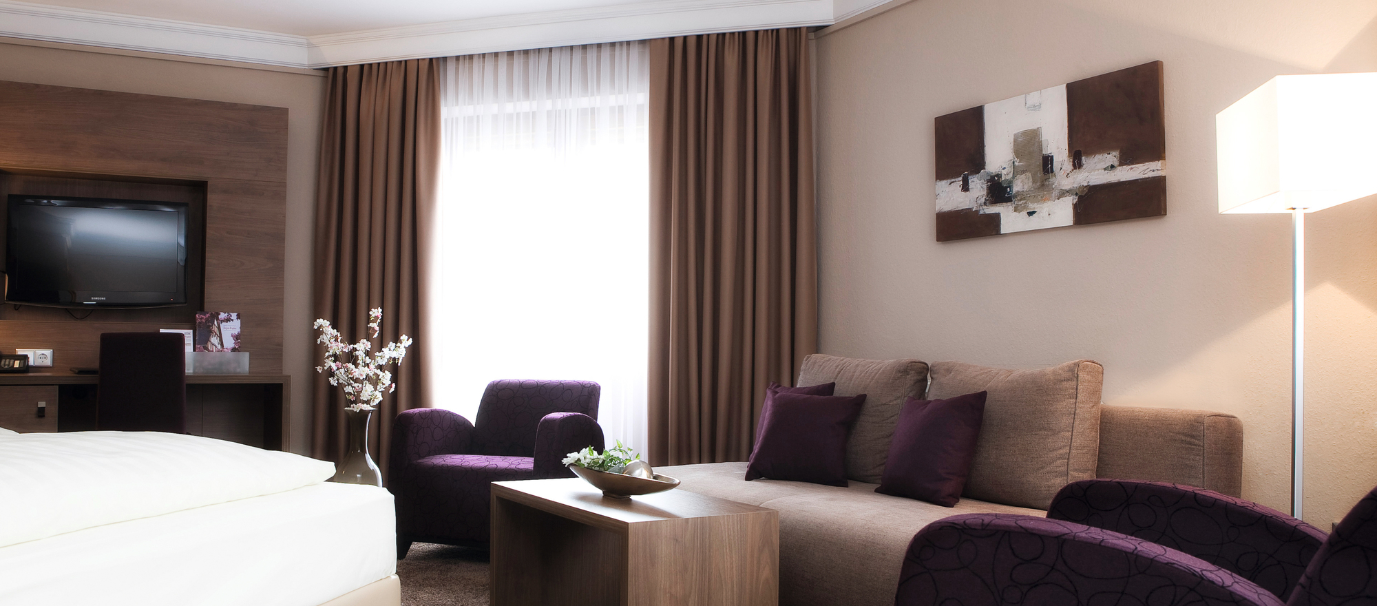 Stylish modern sitting area in the room of the 4-star hotel Ringhotel Nassau-Oranien in Limburg/Hadamar