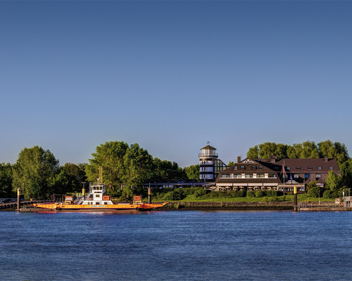 View over the Weser river to the idyllic located hotel Ringhotel Faehrhaus Farge in Bremen-Farge