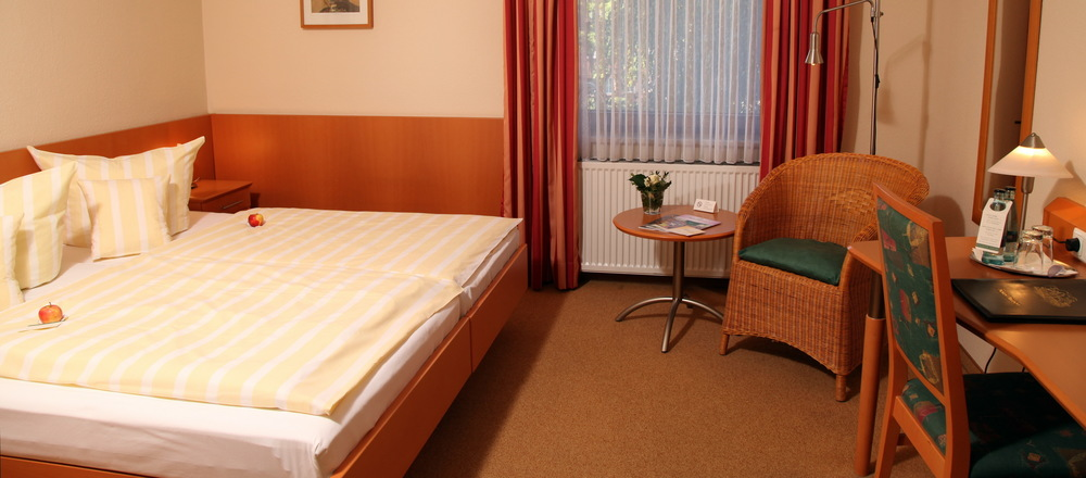 Spacious bright rooms with extra seating accommodation in the 3-star-superior hotel Ringhotel Paulsen in Zeven