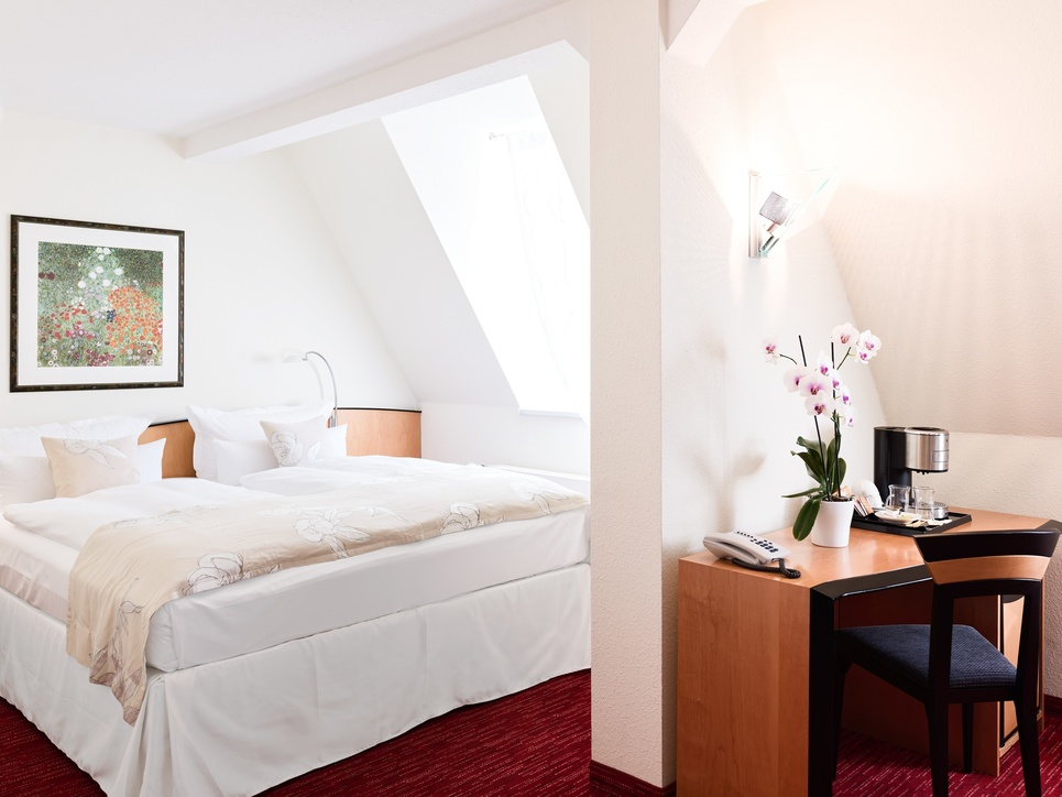 Bright and friendly bedroom in the suite at the 4-star-superior Ringhotel Vitalhotel ambiente in Bad Wilsnack
