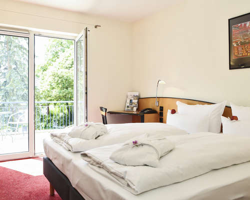 Bright and friendly rooms with balcony in the 4-star-superior Ringhotel Vitalhotel ambiente in Bad Wilsnack