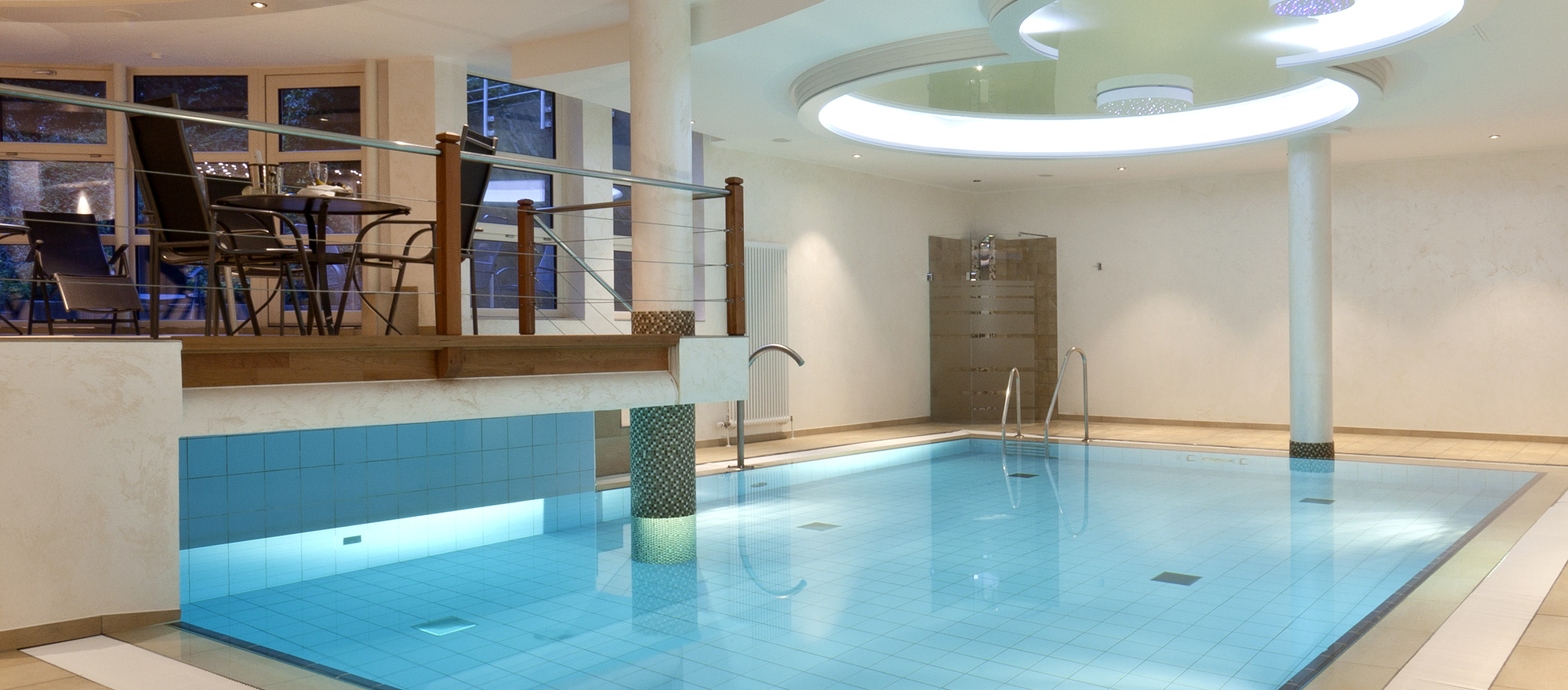 Attractive designed pool area in the 4-star hotel Ringhotel Am Stadtpark in Luenen