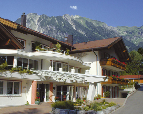 Forefront with terrace of the the 4-star hotel Ringhotel Rheinhotel Ferienhotel Nebelhornblick in Oberstdorf