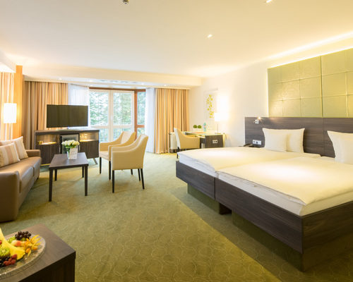 Spacious designed room located to the garden terrace at the 4-star-superior hotel Ringhotel Celler Tor in Celle