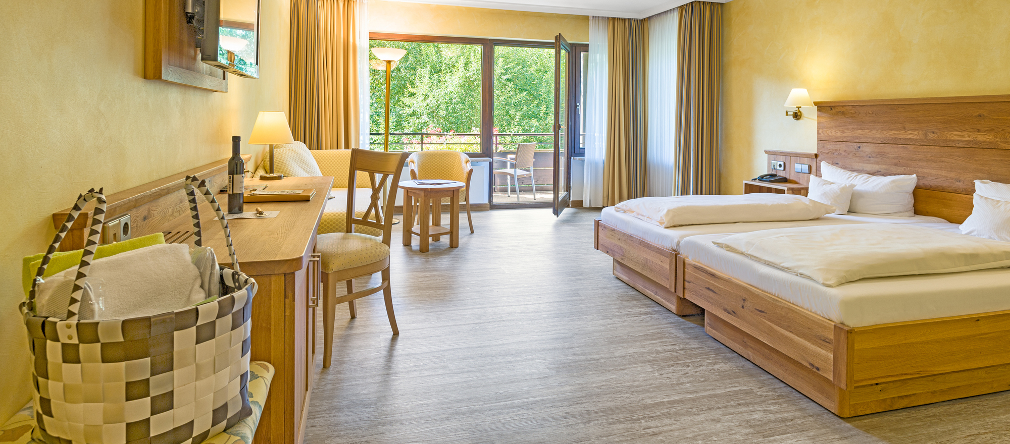 Comfort double room with south-facing balcony invite to relax at the Ringhotel Moenchs Waldhotel, 4-star hotel  in Unterreichenbach