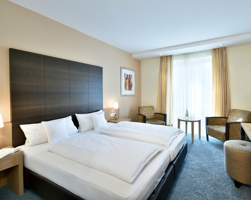 Stylishly attractively superior room at the Ringhotel Koehlers Forsthaus in Aurich, 4-star-hotel at the North Sea coast